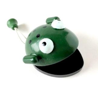 Legetøjs kastagnette som frø