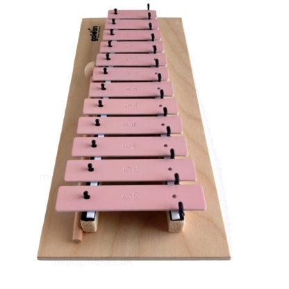 klokkespil instrument i træ og rosa tangenter
