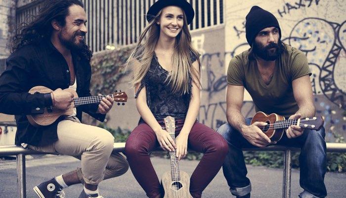 Three musicians with ukuleles