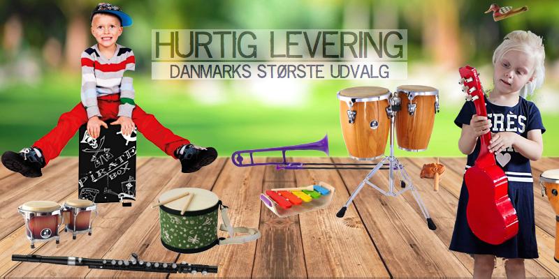 Danmarks største udvalg af musikinstrumenter til læring og leg. En dreng på en cajontromme og og en lille pige med en guitar.