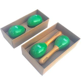 Sær med fire små rytmeinstrumenter af træ. Grønne