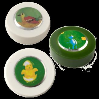 tre små knapper med dyrelyde