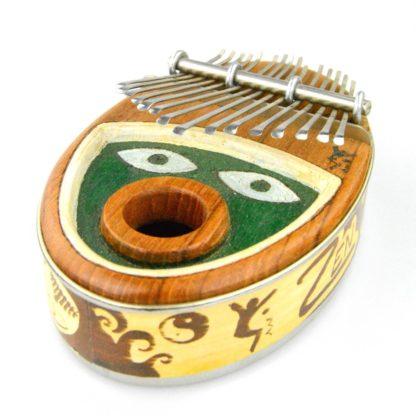 Kalimba med ansigt i grøn